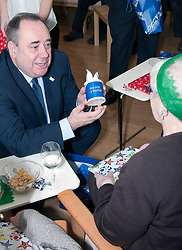 First Minister Alex Salmond, accompanied by Santa Clause (Arthur Martin), visited the Dean Club in Stiockbridge Edinburgh today to distribute Christmas presents to the residents. The First Minister had a long chat with Isobel Reid. (c) GER HARLEY | StockPix.eu