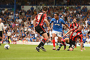Andy Parrish tackles Kyle Bennett in the penalty area late on during the Sky Bet League 2 match between Portsmouth and Morecambe at Fratton Park, Portsmouth, England on 22 August 2015. Photo by David Charbit.