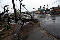 May 3, 2019 - Uprooted electric poles and other things lie in Puri district after Cyclone Fani hit the coastal eastern state of Odisha, India, May 3, 2019. Three people died in India's eastern state of Odisha as the extremely severe cyclone Fani hit the state on Friday morning and continued till beyond noon..A large number of trees and electricity poles were uprooted, and power supply was cut off in many parts of the state. Many areas in Puri of Odisha and other places were submerged as heavy rain battered the coast. (Credit Image: © Stringer/Xinhua via ZUMA Wire)