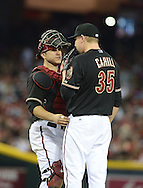 PHOENIX, AZ - JUNE 08:  Catcher Miguel Montero #26 and pitcher Trevor Cahill #35 of the Arizona Diamondbacks talk on the mound in the game against San Francisco Giants at Chase Field on June 8, 2013 in Phoenix, Arizona. The Giants defeated the Diamondbacks 10-5.  (Photo by Jennifer Stewart/Getty Images) *** Local Caption *** Miguel Montero; Trevor Cahill