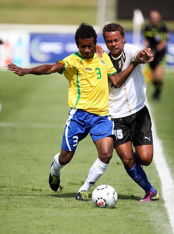 Fiji's Misaele Draunibaka, right, is challenged by Solomon Island's Freddie Kini in the teams OFC Mens Olympic qualifier football match, Owen Delany Park, Taupo, New Zealand, Friday, March 16, 2012. Credit:SNPA / John Cowpland