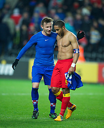 SWANSEA, WALES - Tuesday, March 26, 2013: Wales' captain Ashley Williams walks off dejected after his side lose 2-1 to Croatia as Ivica Olic looks on during the 2014 FIFA World Cup Brazil Qualifying Group A match at the Liberty Stadium. (Pic by David Rawcliffe/Propaganda)