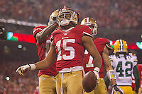 12 January 2013: Wide receiver (15) Michael Crabtree of the San Francisco 49ers scores a touchdown and celebrates with (85) Vernon Davis against the Green Bay Packers during the first half of the 49ers 45-31 victory over the Packers in an NFL Divisional Playoff Game at Candlestick Park in San Francisco, CA.