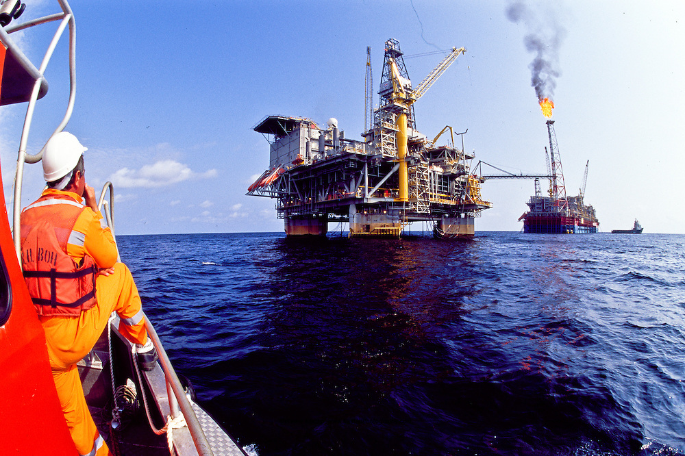 Tension leg platform (TLP) foreground (FPSO) Floating Production Storage and Offloading in background, offshore of Angola