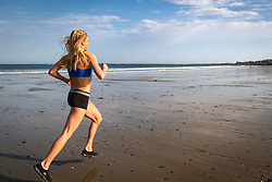 Erica Jesseman, 26, trains for marathon on Scarborough Beach in Maine