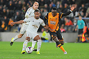 Wayne Routledge  and Moses Odubajo  tussel for the ball during the Capital One Cup match between Hull City and Swansea City at the KC Stadium, Kingston upon Hull, England on 22 September 2015. Photo by Ian Lyall.