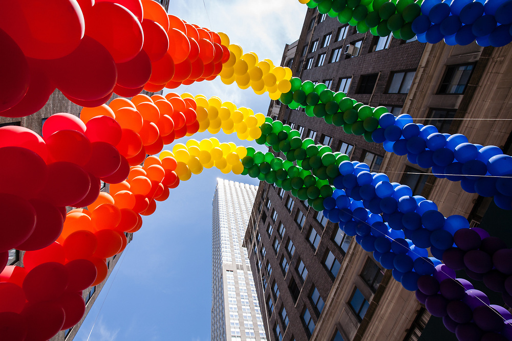 New York, NY - 25 June 2017. New York City Heritage of Pride March filled Fifth Avenue for hours with groups from the LGBT community and it's supporters. Pride staff prepare the rainbow arch of balloons on East 36th Street prior to the start of the parade.