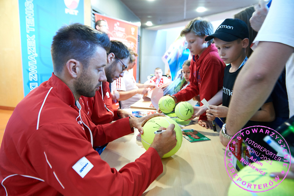 (L-R) Michal Przysiezny and Jerzy Janowicz both from Poland while their autographs session during Davis Cup Tie World Group Play-off Poland v Slovakia at Gdynia Arena Hall in Gdynia, Poland.<br /> <br /> Poland, Gdynia, September 19, 2015<br /> <br /> Picture also available in RAW (NEF) or TIFF format on special request.<br /> <br /> For editorial use only. Any commercial or promotional use requires permission.<br /> <br /> Adam Nurkiewicz declares that he has no rights to the image of people at the photographs of his authorship.<br /> <br /> Mandatory credit:<br /> Photo by &copy; Adam Nurkiewicz / Mediasport