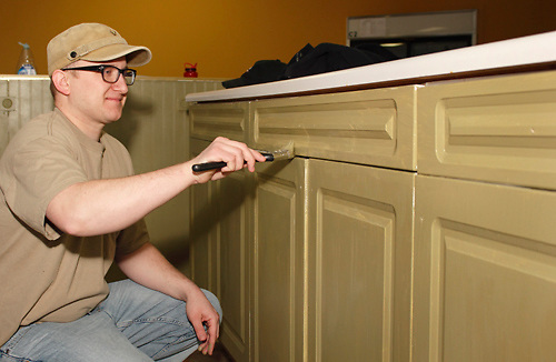 Dan Watson of Englewood helps the Ginghamsburg Church create a new church on East Main Street in Trotwood, Saturday, February 4, 2012.  The church church will share space with the YMCA.