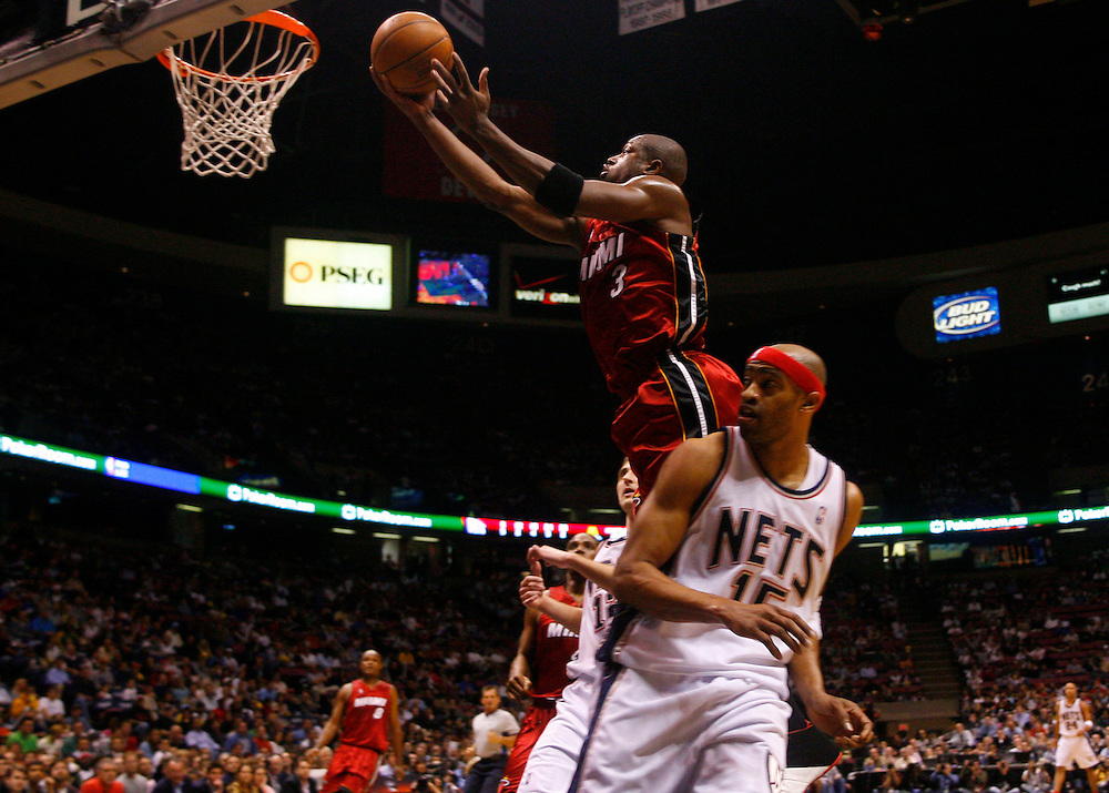 Dwyane Wade of the Miami Heat goes to the basket as Vince Carter of the New Jersey Nets at The Continental Airlines Arena in East Rutherford New Jersey. Sunday 14 May 2006 (Andrew Gombert for the New York Times)