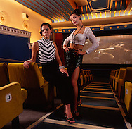 Two girls at art deco cinema in vintage clothing