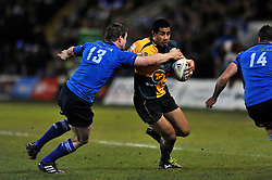 Ken Pisi (Northampton) is tackled by Brian O'Driscoll (Northampton) - Photo mandatory by-line: Patrick Khachfe/JMP - Tel: Mobile: 07966 386802 07/12/2013 - SPORT - RUGBY UNION -  Franklin's Gardens, Northampton - Northampton Saints v Leinster - Heineken Cup.