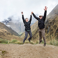Peru, Hikers leap to celebrate 13,800' summit of Dead Woman's Pass along Inca Trail to Machu Picchu along Urubamba River