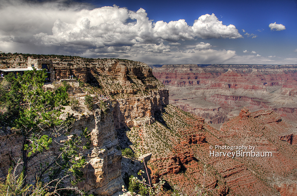 Grand Canyon National Park, Arizona. Dramatic cumulus clouds, red sandstone buttes.