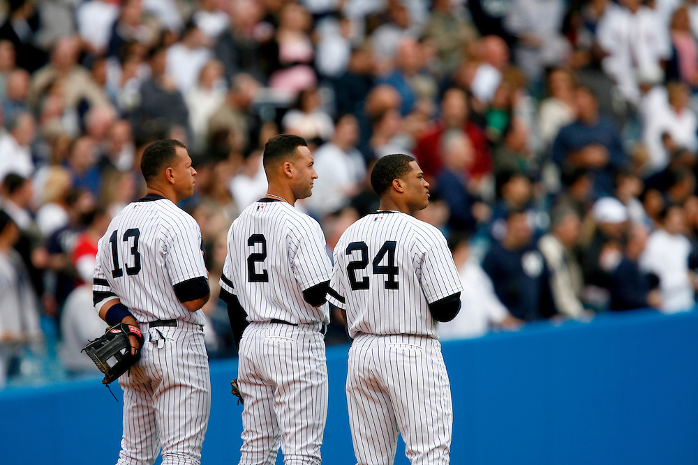 NEW YORK - APRIL 29: Alex Rodriguez #13, Derek Jeter #2 and Robinson Cano #2 of the New York Yankees stand for the National Anthem before a game against the Boston Red at Yankee Stadium on April 29, 2007 in the Bronx borough of New York City. The Red Sox defeated the Yankees 7 to 4.