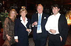 Left to right, VISCOUNTESS GORMANSTON,  MR & MRS CHRISTOPHER SPENCE and CHARLIE BROOKS at a party to celebrate the launch of Ladies' Day at The Vodafone Derby Festival held at Frankie's Bar & Grill, 3 Yeomans Row, London SW7 on 19th April 2005.<br />