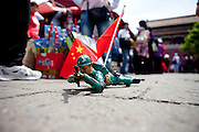 """Chinese army toy soldier"" crawling on the ground, for sale at a stand located in ""The Forbidden City"" which was the Chinese imperial palace from the Ming Dynasty to the end of the Qing Dynasty. It is located in the middle of Beijing, China. Beijing is the capital of the People's Republic of China and one of the most populous cities in the world with a population of 19,612,368 as of 2010."