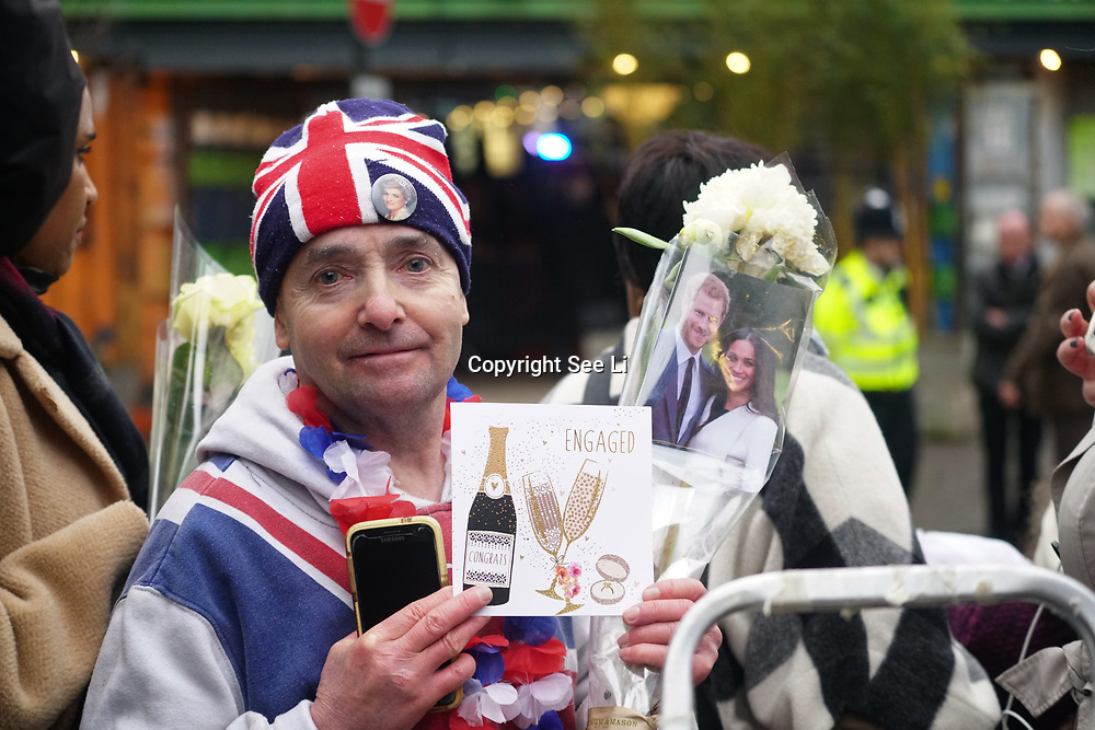 London, England, UK. 9th January 2018. A guy holding a banner with Prince Harry and Meghan photo during outside Reprezent 107.3FM Radio station.