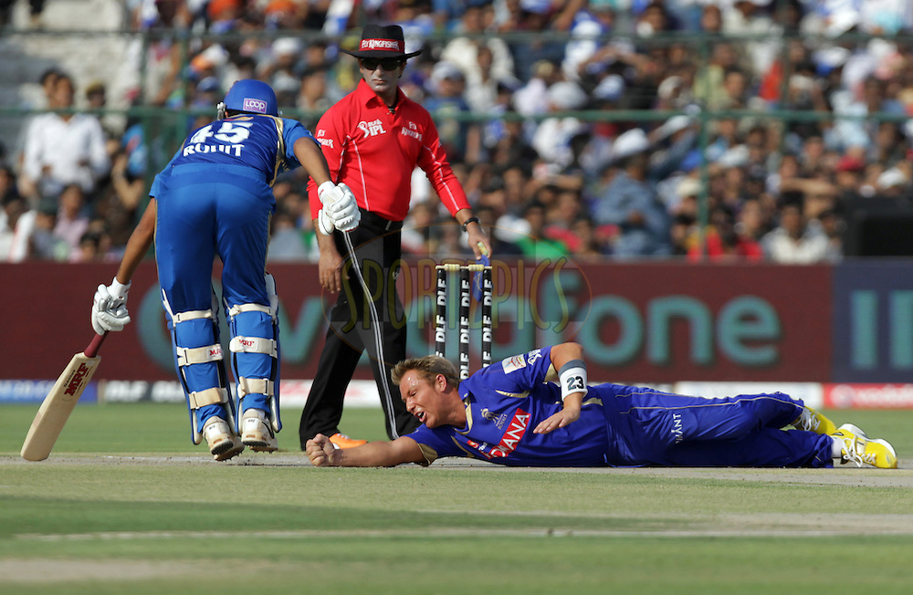Rajasthan Royals captain Shane Warne dives to stop the ball during match 34 of the the Indian Premier League ( IPL ) Season 4 between the Rajasthan Royals and the Mumbai Indians held at the Sawai Mansingh Stadium, Jaipur, Rajasthan, India on the 29th April 2011..Photo by BCCI/SPORTZPICS..