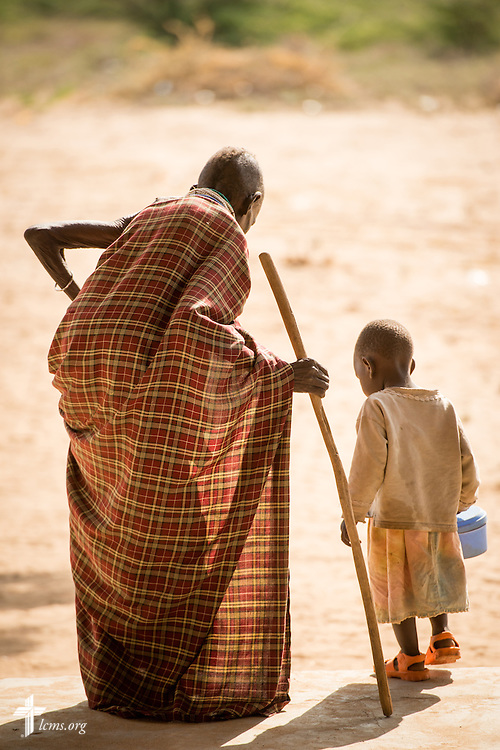 An elderly patient and young child leave following treatment at the LCMS Mercy Medical Team on Monday, June 20, 2016, in Nataparkakono, a village in Turkana, Kenya.  LCMS Communications/Erik M. Lunsford