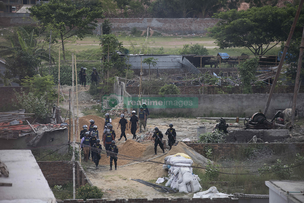 April 29, 2019 - Dhaka, Bangladesh - Members of Rapid Action Battalion (RAB) stand guard at the scene of an operation to storm an alleged militants hideout in Dhaka on April 29, 2019. RAB claimed two suspected militants were killed in a shootout with them during the raid. (Credit Image: © Ahmed Salahuddin/NurPhoto via ZUMA Press)