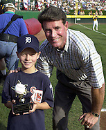 """Baseball Hall of Fame pitcher Jim Palmer (R) poses with Evan McDaniel (L), who wrote the essay that won the contest for his Leesburg, Virginia Little League team after giving the """"OxiClean True Grit"""" award to him, before the start of the Little League World Series Championship Game, Sunday, August 25, 2002, in South Williamsport, Pennsylvania. (Photo by William Thomas Cain/photodx.com)"""