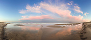 The settting sun lights up clouds over Nauset Beach on an early September evening.