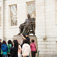 "Tourists surround the statue in Harvard Yard. Touching his foot was supposed to bring good luck. The statue has earned the nickname ""the statue of three lies"" from its inscription, ""John Harvard, Founder, 1638"". In truth, the statue is not modeled after John Harvard, he did not found the university, and the founding was in 1636"