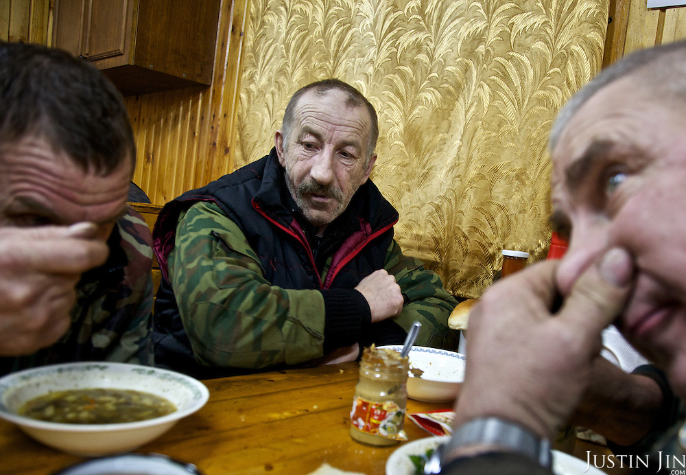 "Truck drivers at the oil and gas prospecting company ""Siesmorevzedka"" eat together after work in the Arctic tundra. Typically, they work in the cold, isolated Arctic tundra for the entire winter, returning to civilisation only in spring."