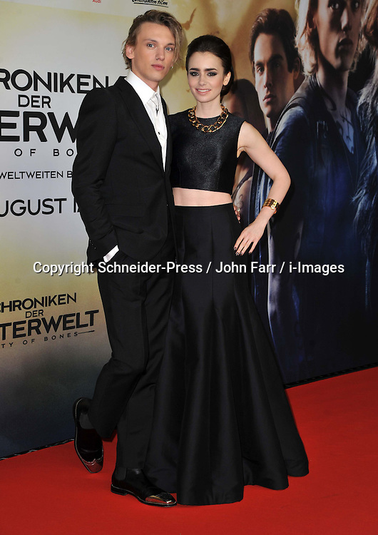 Lily Collins and Jamie Campbell Bower arrives for the 'The Mortal Instruments: City of Bones' Germany premiere at Sony Centre on Tuesday August 20, 2013 in Berlin, Germany. Photo by Schneider-Press / John Farr / i-Images. <br /> UK & USA ONLY