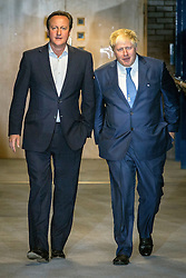 **FILE PICTURE- David Cameron and Boris Johnson will will campaign against each other ahead of an EU Referendum on June 23rd, 2016**© Licensed to London News Pictures . 29/09/2014 . Birmingham , UK . British Prime Minister David Cameron and the Mayer of London Boris Johnson cross over the bridge from the Hyatt Hotel to the ICC . The 2014 Conservative Party Conference at the International Convention Centre in Birmingham . Photo credit : Joel Goodman/LNP