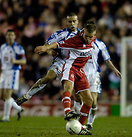 Photo: Jed Wee.<br /> Middlesbrough v Nuneaton Borough. The FA Cup. 17/01/2006.<br /> <br /> Middlesbrough's Lee Cattermole (R) tries to control the ball under pressure from Nuneaton's Matty Collins.