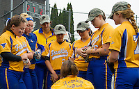 Franklin's Jenn Dorval (kneeling down) talks to the players at the bottom of the 7th inning during NHIAA DIvision III softball state championships at PSU on Saturday afternoon.  (Karen Bobotas/for the Laconia Daily Sun)