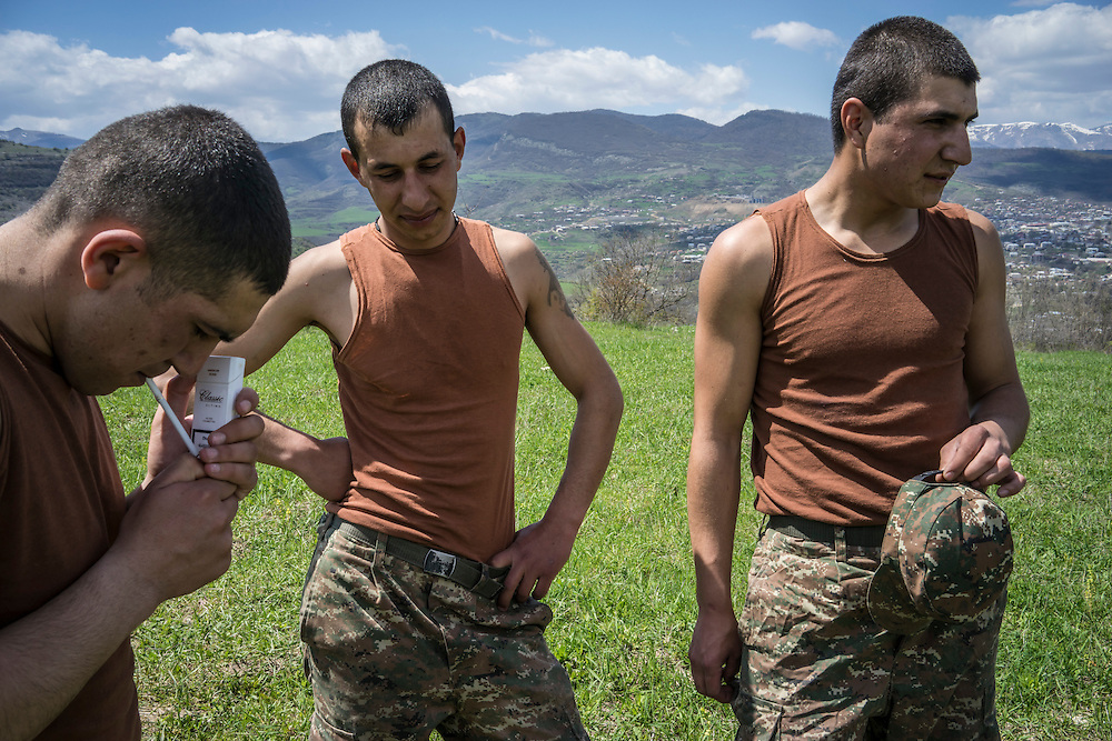 KARASHEN, NAGORNO-KARABAKH - APRIL 19: Narek Martirosyan, Shavalat Sargsyan, and Samson Israelyan (L-R), Armenian soldiers from Spitak, relax and have a picnic on a hill overlooking Stepanakert on April 19, 2015 in Karashen, Nagorno-Karabakh. Since signing a ceasefire in a war with Azerbaijan in 1994, Nagorno-Karabakh, officially part of Azerbaijan, has functioned as a self-declared independent republic and de facto part of Armenia, with hostilities along the line of contact between Nagorno-Karabakh and Azerbaijan occasionally flaring up and causing casualties. (Photo by Brendan Hoffman/Getty Images) *** Local Caption *** Narek Martirosyan;Shavalat Sargsyan;Samson Israelyan
