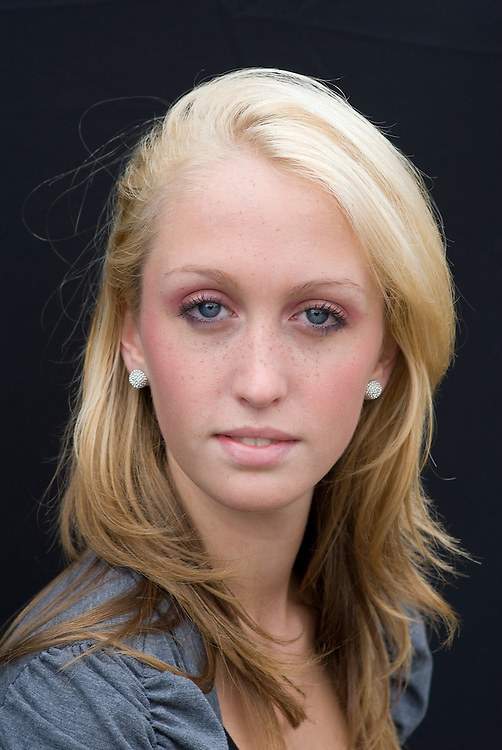A beauty portrait of a beautiful blonde young Western woman (girl).