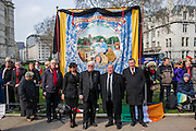 Tony Benn's funeral at 11.00am at St Margaret's Church, Westminster. His body was brought in a hearse from the main gates of New Palace Yard at 10.45am, and was followed by members of his family on foot. The rout was lined by admirers. On arrival at the gates it was carried into the church by members of the family. Thursday 27th March 2014, London, UK.