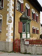 "A house built in 1564 shows characteristic architecture in Baselgia, Upper Engadine, Switzerland, the Alps, Europe. Sgraffito (or scraffito, plural: sgraffiti) is a technique of wall decor where layers of plaster tinted in contrasting colors are applied to a moistened surface. The Swiss valley of Engadine translates as the ""garden of the En (or Inn) River"" (Engadin in German, Engiadina in Romansh, Engadina in Italian)."