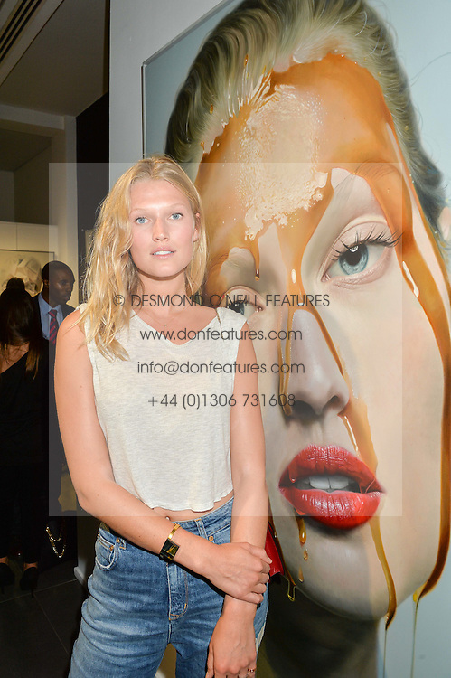 Model TONI GARRN at a private view of woks by German artist Mike Dargas held at the Opera Gallery, 134 New Bond Street, London on 5th July 2016.