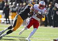 November 23 2012: Nebraska Cornhuskers running back Braylon Heard (5) is hit by Iowa Hawkeyes defensive back Tanner Miller (5) during the first half of the NCAA football game between the Nebraska Cornhuskers and the Iowa Hawkeyes at Kinnick Stadium in Iowa City, Iowa on Friday November 23, 2012. Nebraska defeated Iowa 13-7 in the Heroes Game on Black Friday.