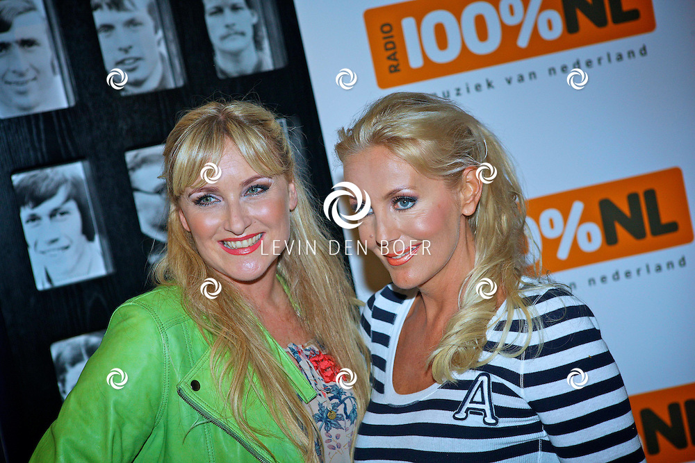 AMSTERDAM - De Toppers in Concert 2012 The Loveboat Edition in de Amsterdam Arena in Amsterdam. Met links op de foto Danielle Mulder en rechts Mandy Huydts. FOTO LEVIN DEN BOER - PERSFOTO.NU