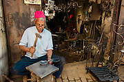 Metalworkers in the narrow almost medieval alleys of the Marrakech souks