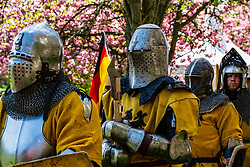 German knights prepare for combat during the  International Medieval Combat Federation (IMCF) World Championships  at Scone Palace on May 12, 2018 at Scone Palace in Perth, Scotland.