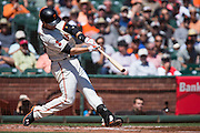 San Francisco Giants catcher Buster Posey (28) hits a base hit against the Arizona Diamondbacks at AT&T Park in San Francisco, Calif., on August 31, 2016. (Stan Olszewski/Special to S.F. Examiner)