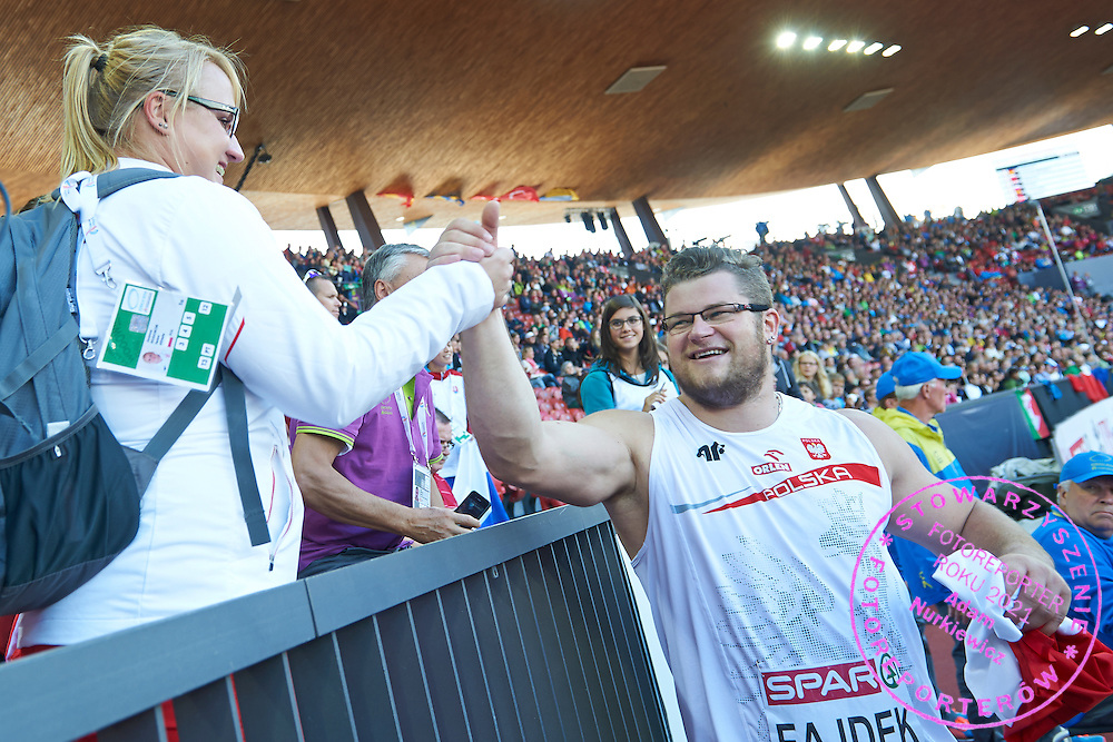 (R) Pawel Fajdek celebrates his silver medal in men's hammer throw with (L) Joanna Fiodorow bronze medalist in women's hammer throw  during the Fifth Day of the European Athletics Championships Zurich 2014 at Letzigrund Stadium in Zurich, Switzerland.<br /> <br /> Switzerland, Zurich, August 16, 2014<br /> <br /> Picture also available in RAW (NEF) or TIFF format on special request.<br /> <br /> For editorial use only. Any commercial or promotional use requires permission.<br /> <br /> Photo by &copy; Adam Nurkiewicz / Mediasport