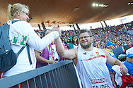 (R) Pawel Fajdek celebrates his silver medal in men's hammer throw with (L) Joanna Fiodorow bronze medalist in women's hammer throw  during the Fifth Day of the European Athletics Championships Zurich 2014 at Letzigrund Stadium in Zurich, Switzerland.<br /> <br /> Switzerland, Zurich, August 16, 2014<br /> <br /> Picture also available in RAW (NEF) or TIFF format on special request.<br /> <br /> For editorial use only. Any commercial or promotional use requires permission.<br /> <br /> Photo by © Adam Nurkiewicz / Mediasport