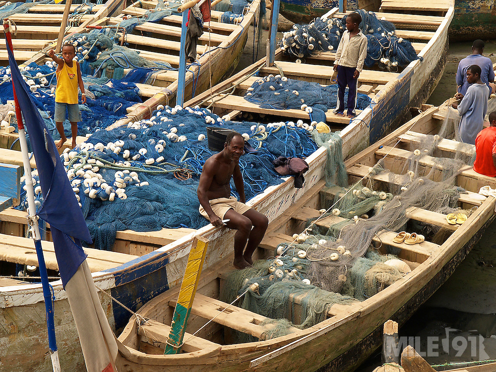 Fishermen and their boats, Ghana