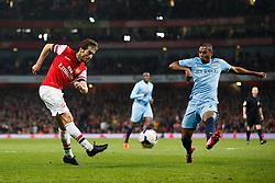 Arsenal Midfielder Mathieu Flamini (FRA) crosses past Man City Midfielder Fernandinho (BRA) - Photo mandatory by-line: Rogan Thomson/JMP - 07966 386802 - 29/03/14 - SPORT - FOOTBALL - Emirates Stadium, London - Arsenal v Manchester City - Barclays Premier League.