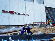02 NOVEMBER 2018 - BANGKOK, THAILAND: Construction workers in front of the Siam Takashimaya store in the ICONSIAM development. ICONSIAM is a mixed-use development on the Thonburi side of the Chao Phraya River. It will include two large malls, with more than 520,000 square meters of retail space, an amusement park, two residential towers and a riverside park. It is the first large scale high end development on the Thonburi side of the river and will feature the first Apple Store in Thailand and the first Takashimaya department store in Thailand.     PHOTO BY JACK KURTZ