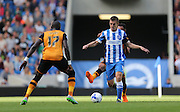 Brighton defender, Uwe Huenemeier in action the Sky Bet Championship match between Brighton and Hove Albion and Hull City at the American Express Community Stadium, Brighton and Hove, England on 12 September 2015.