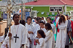 Jean-Carlos Alvarado leads the procession of children during the Stations of the Cross